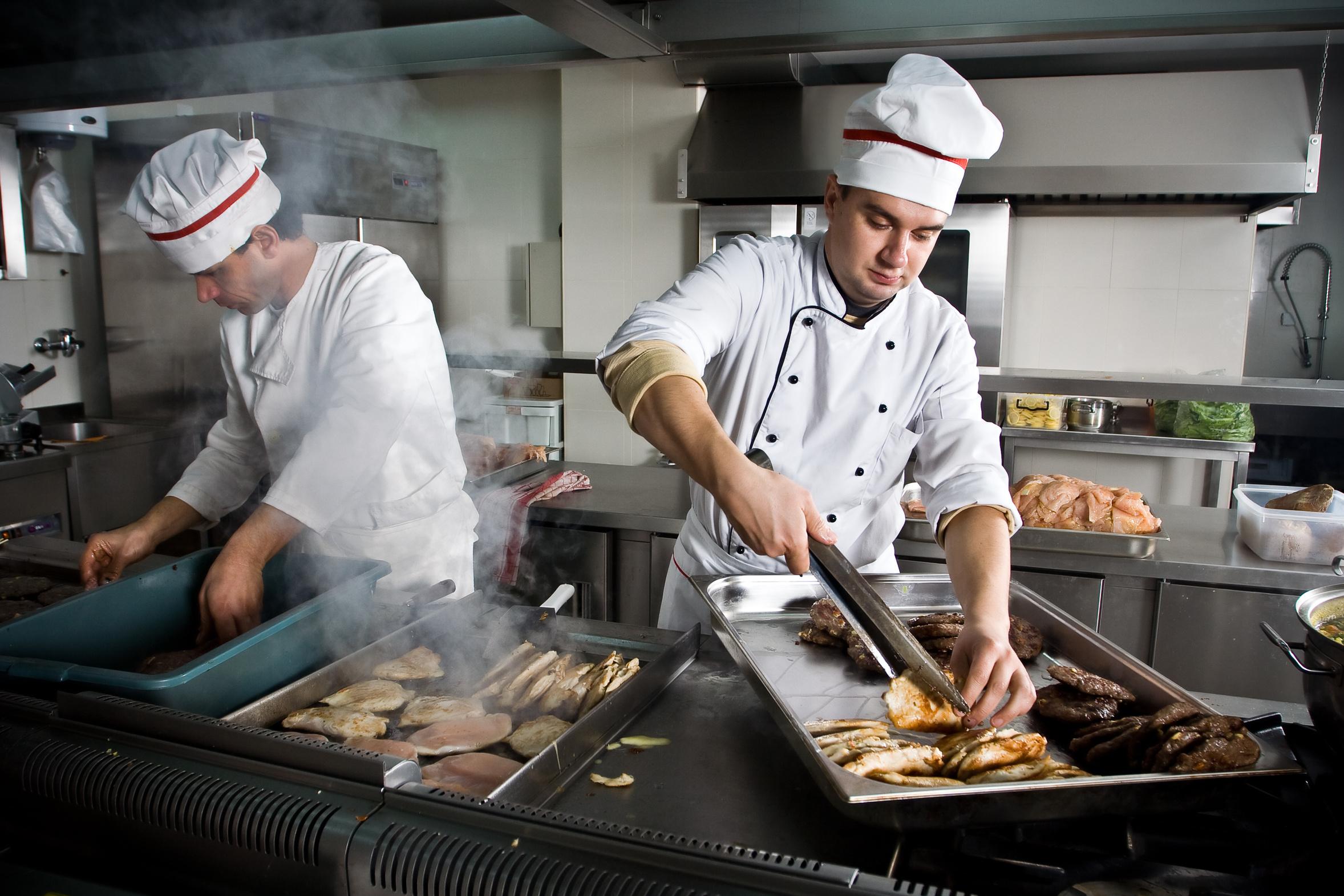 Restaurant Kitchen Chefs two chefs at work in a restaurant - bosabe